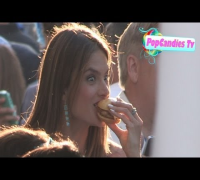 Alessandra Ambrosio enjoys a chicken burger at Monsters University Premiere in Hollywood