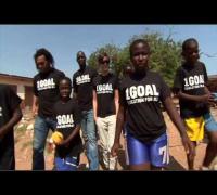 Bono and Jessica Alba visit a school in Ghana