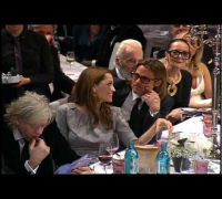 Brad Pitt and Angelina Jolie Bid & Kiss at Peace Auction