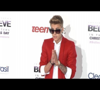"Justin Bieber Causing a Commotion at Justin Bieber's ""Believe"" World Premiere Arrivals"
