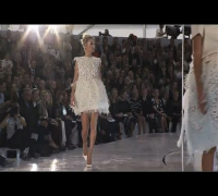 Kate Moss Stuns on Louis Vuitton's Carousel Catwalk