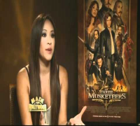 "MILLA JOVOVICH - 35 - ""THE THREE MUSKETEERS"" INTERVIEW WITH CAST & DIRECTOR / HUSBAND 10-20-11 - VOB"