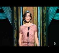 Milla Jovovich en Los Oscars 2011