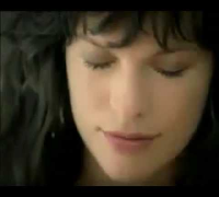 Milla Jovovich in Paris Spring-Summer 2009 Commercial 1 (Spanish)