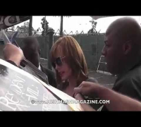 Milla Jovovich Signs Autographs for Fans