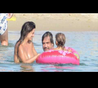 Video - Penelope Cruz goes topless on beach during family holiday